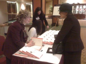Allison Fine signs copies of her book, Momentum